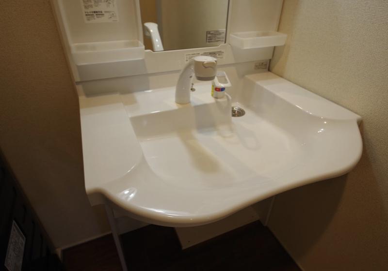 賃貸マンションの洗面室のバリアフリーリフォーム